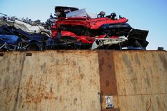 Junk yard. Wrecked cars in a junk yard Stock Image