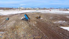 Junk yard from above. Garbage truck unloading waste at a garbage dump. Aerial. 4K stock footage
