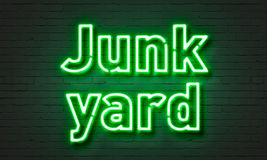 Junk yard neon sign on brick wall background. Stock Photo
