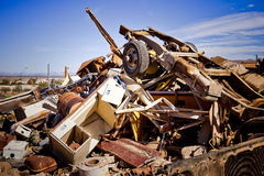 Junk Yard Pile. Giant pile of trash and metal at a desert junk yard stock photos