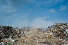 Junk yard view full of smoke, litter, plastic bottles,rubbish and trash at the Thilafushi local tropical island Stock Photo