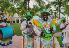 Junkanoo performers dressed in traditional costumes at a festival in Freeport, Bahamas. Freeport Bahamas - September 22, 2011: Male dancers dressed in royalty free stock photos