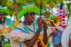 Junkanoo performers dressed in traditional costumes at a festival playing a trumpet in Freeport, Bahamas. Freeport Bahamas - September 22, 2011: Male dancers royalty free stock photos
