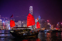 Junkboat sailing across Victoria Harbour Night Scene Stock Images