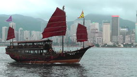 Junkboat in Victoria Harbour Hon Kong stock footage