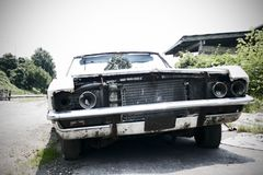 Junked Car - focus in the background. Photo of junked car Stock Images