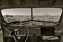 Junked old car in the desert Stock Photo