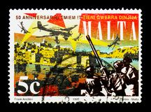 Junkers Ju 87B Stuka Dive Bombers over Valetta and Anti-ai, se. MOSCOW, RUSSIA - NOVEMBER 26, 2017: A stamp printed in Malta shows Junkers Ju 87B Stuka Dive stock photo