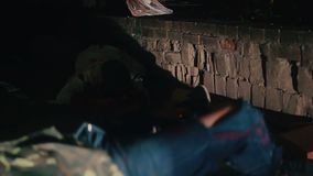 Junkies barely moving in darkness, drug addiction problem, hangover after party stock footage