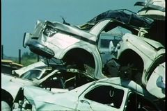 Junkyard filled with cars stock video footage