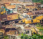 Colorful junkyard of heavy machinery stock photography