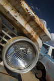 Junkyard Headlight. The headlight of an old vintage truck in a junkyard royalty free stock images