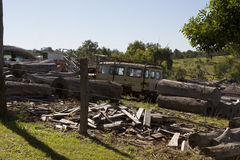 Junkyard with logs and old agricultural machinery Royalty Free Stock Photography