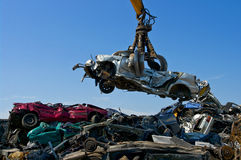 Junkyard picking up car stock photography