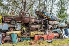 Junkyard pile up of old vintage vehicles stock image