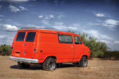 Junkyard Surfer Van. A old orange surfer van in a junkyard royalty free stock photo