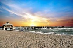 Juno Beach Pier. The Juno Beach Fishing Pier, Florida at sunrise on a windy summer day Stock Photos