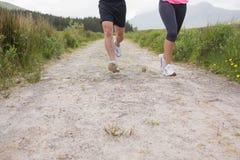 Junta los pies que corren en un rastro Imagen de archivo