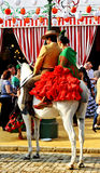 Junte el montar a caballo en la feria de Sevilla, Andalucía, España Imágenes de archivo libres de regalías