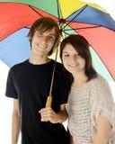 Junto bajo el paraguas Fotografía de archivo libre de regalías