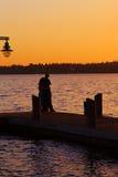 Junto en la puesta del sol Imagen de archivo libre de regalías
