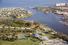 Jupiter, FL Inlet and Light House. Shows aerial photo of Jupiter Inlet and the light house as well as part of the town and the Atlantic.  Huge condos line the Stock Photo