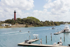 Jupiter Florida Inlet. Jupiter, FL, USA - March 30, 2017: Boat docks and people on jet skis, boats and paddle boards in the Loxahatchee River. People on Stock Images