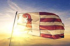 Jura canton of Switzerland flag textile cloth fabric waving on the top sunrise mist fog. Beautiful vector illustration