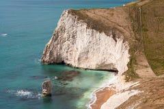 Jurassic Coast Cliffs Dorset England. White chalk cliffs of Bats Head promontory and Butler Rock on the Jurassic Coast. Dorset, England, UK royalty free stock photo