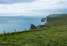 Jurassic Coast cliffs. Scenic view of Jurassic Coast by St Oswald´s Bay, Dorset, England Royalty Free Stock Images