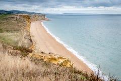 Dorset Jurassic coast West Bay. Jurassic coast West Bay Dorset Uk England showing the cliffs beach and sea stock photo