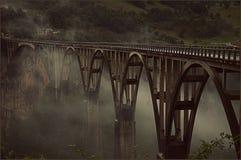 Bridge Djurdjevica Tara in the fog royalty free stock image