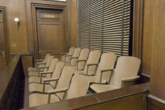 Juries Seating In Court. Empty jury box in the courthouse royalty free stock photos