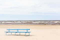 Jurmala beach. A bench in the sand at the beach in Jurmala Royalty Free Stock Photo