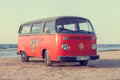 Jurmala, Latvia - May 28, 2016: vintage bus on the beach. Jurmala, Latvia - May 28, 2016: vintage red volkswagen bus on beach near the Baltic Sea. Jurmala stock photo