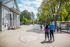 Jurmala, Latvia. Street near the Dzintari Concert Hall. A couple walking Royalty Free Stock Photos