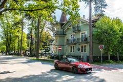 Jurmala Latvia. Jurmala, Latvia wooden houses hotels and luxurious cars Stock Photo