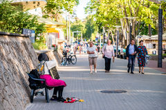 Jurmala street with live musician Stock Images