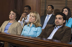 Jurors Sitting In Courtroom During Trial. Diverse group of jurors sitting in jury box of a courtroom during trial royalty free stock photography