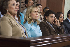 Jurors During Trial. Group of jurors sitting in courtroom during trial stock photography