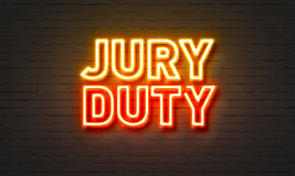 Jury duty neon sign on brick wall background. Jury duty neon sign on brick wall background royalty free stock photos