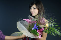 Jury offering flowers. Young dancer receiving from jury golden medal stock photography
