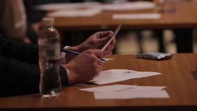 Jury sitting at table, making notes during beauty contest, competition