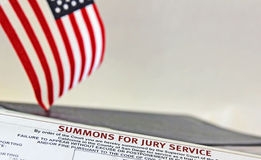 Jury Summons. Summons for jury service with a portion of an image of US flag royalty free stock images
