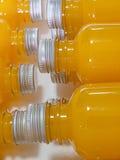 Jus d'orange dans la bouteille Images libres de droits