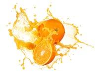 Jus d'orange het bespatten Stock Afbeeldingen