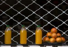 Jus d'orange op een rij Stock Afbeelding