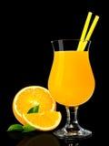 Jus d'orange op zwarte Royalty-vrije Stock Foto