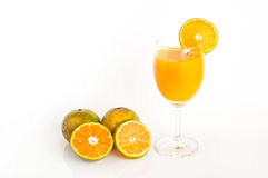 Jus d'orange sur le fond blanc Photos libres de droits
