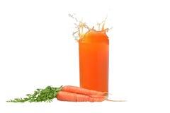 Jus de carotte et carotte Photographie stock